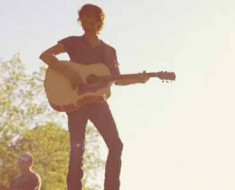 "Photo: Chris Janson sings in ""Buy Me a Boat"" music video."