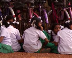 Photo of Indian school girls sitting outside.